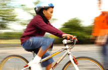 blurred child on bike